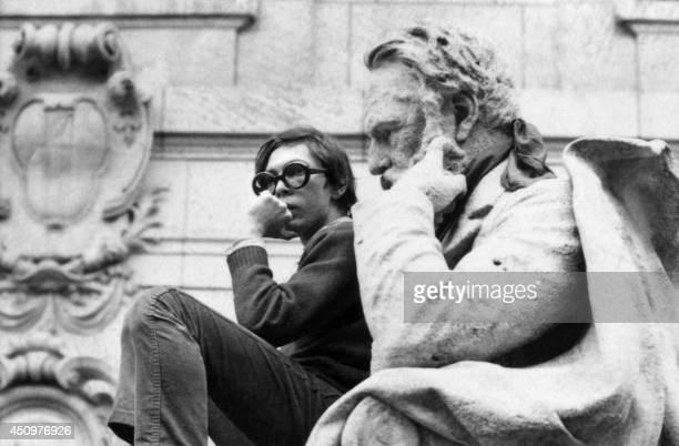 A student sits on the knee of Victor Hugo's statue in Paris Sorbonne courtyard during a demonstration in Paris on May 14 1968 during the May 1968...