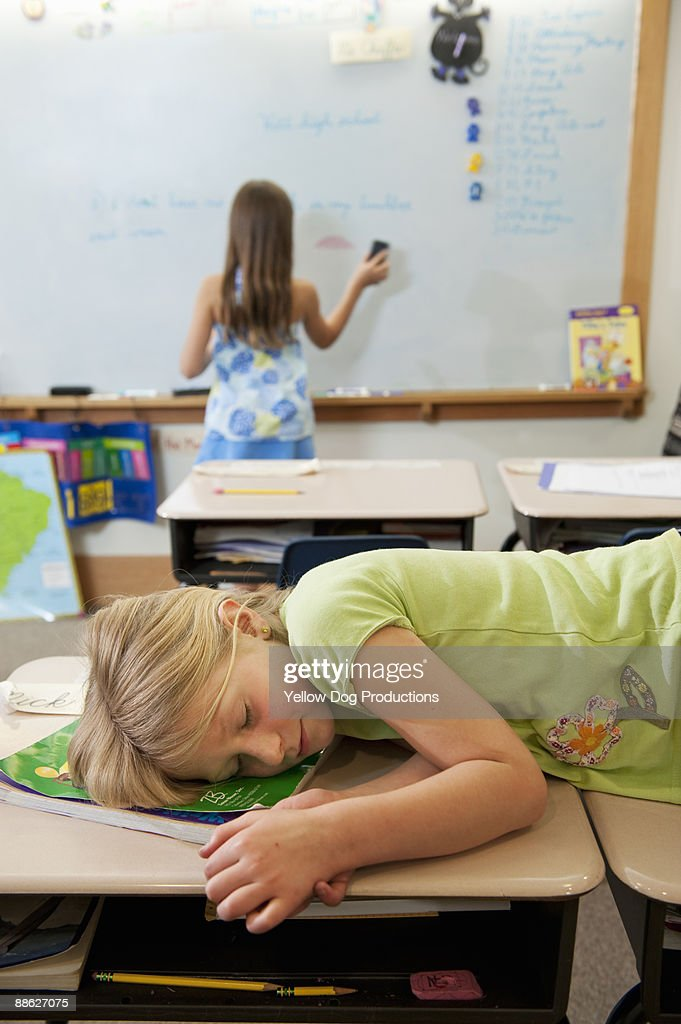 Student sleeping in classroom : Stock Photo