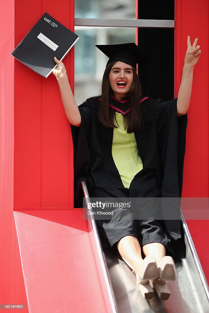 A student slides down an installation on the South Bank ahead of her graduation ceremony at the Royal Festival Hall on July 15, 2014 in London, England. Students of the London College of Fashion, Management and Science and Media and Communication attended their graduation ceremony at the Royal Festival Hall today.