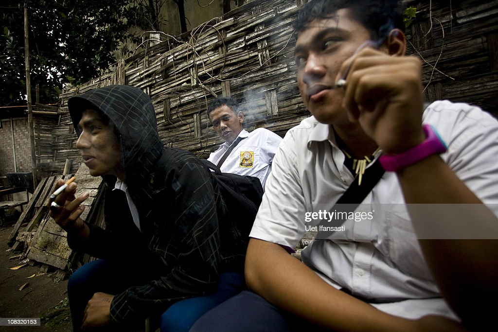 Student smoke after school on January 25, 2011 in Yogyakarta, Indonesia. It is estimated that over 25 percent of children in Indonesia over the age of three have tried smoking, with over three percent of them smoking regularly. The lack of government regulation around advertising is blamed for the problem, with campaigns seen heavily at sporting events, music concerts. The Indonesian government previously passed a health bill in 2009 to address the issues, but it has not yet been implemented.