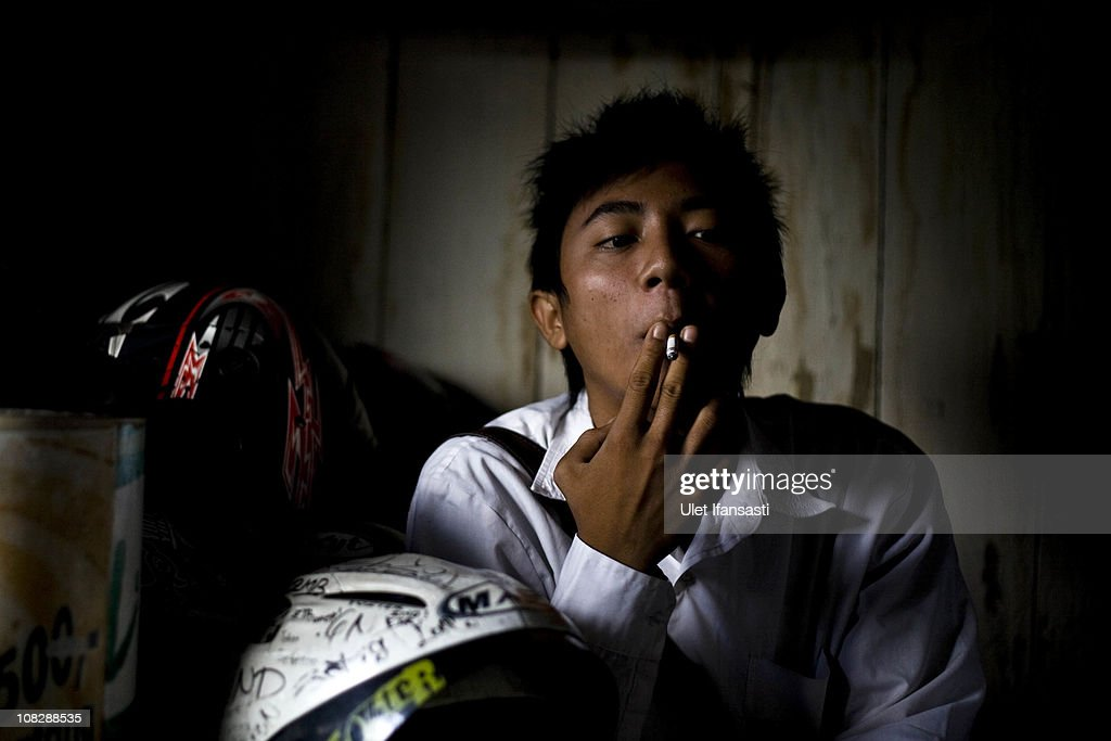 A student smokes before attending school on January 24, 2011 in Yogyakarta, Indonesia. It is estimated that over 25 percent of children in Indonesia over the age of three have tried smoking, with over three percent of them smoking regularly. The lack of government regulation around advertising is blamed for the problem, with campaigns seen heavily at sporting events, music concerts. The Indonesian government previously passed a health bill in 2009 to address the issues, but it has not yet been implemented.
