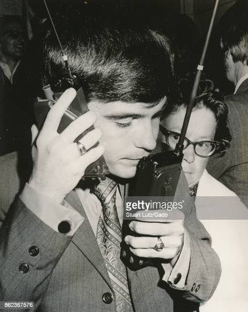 Student speaking into two walkie talkie radios at once during an anti Vietnam War student sitin protest at North Carolina State University Raleigh...