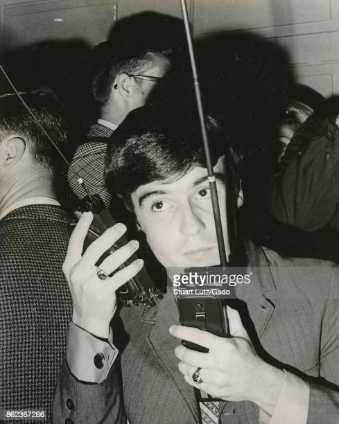 A student speaks on two walkie talkie portable radios at once while coordinating an anti Vietnam War student sitin protest at North Carolina State...
