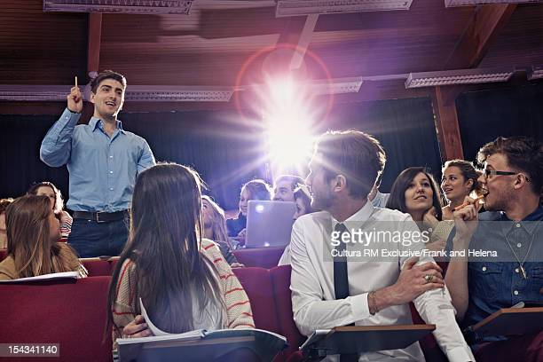 Student standing up in class