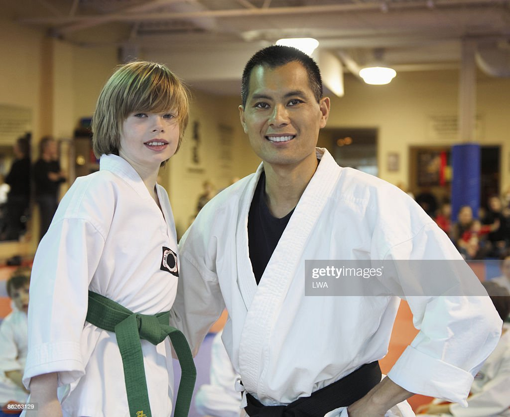 Student Standing With Tae Kwon Do Master : Stock Photo