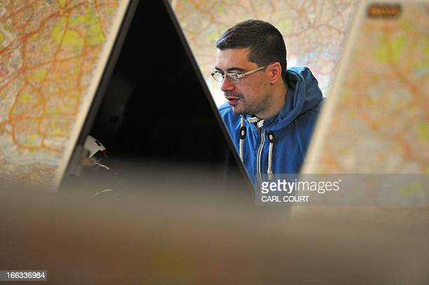 A student studies a map of London in a test centre in north London on February 28 2013 All London Black Cab drivers are required to pass the...