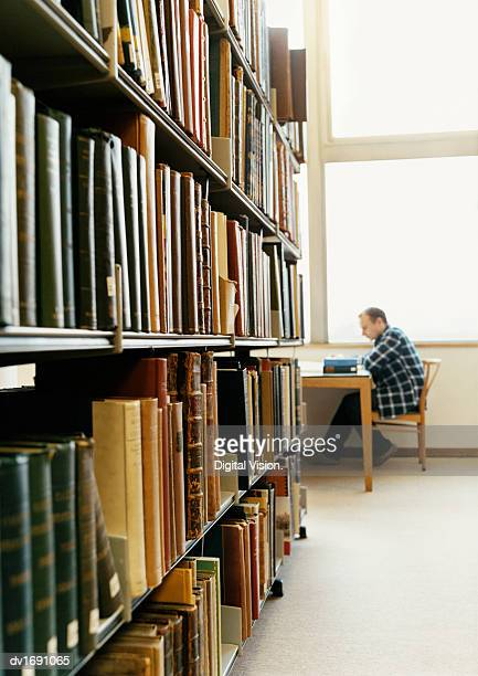 Student Studying in a University Library