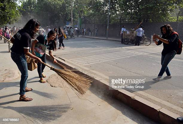 A student take photo DU Student during Swachh Bharat Abhiyan' in Delhi The nationwide campaign aims to clean up India in five years at DU in New...