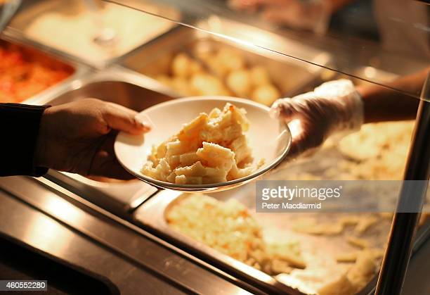 A student takes a plate during lunch time at a secondary school on December 1 2014 in London England Education funding is expected to be an issue in...
