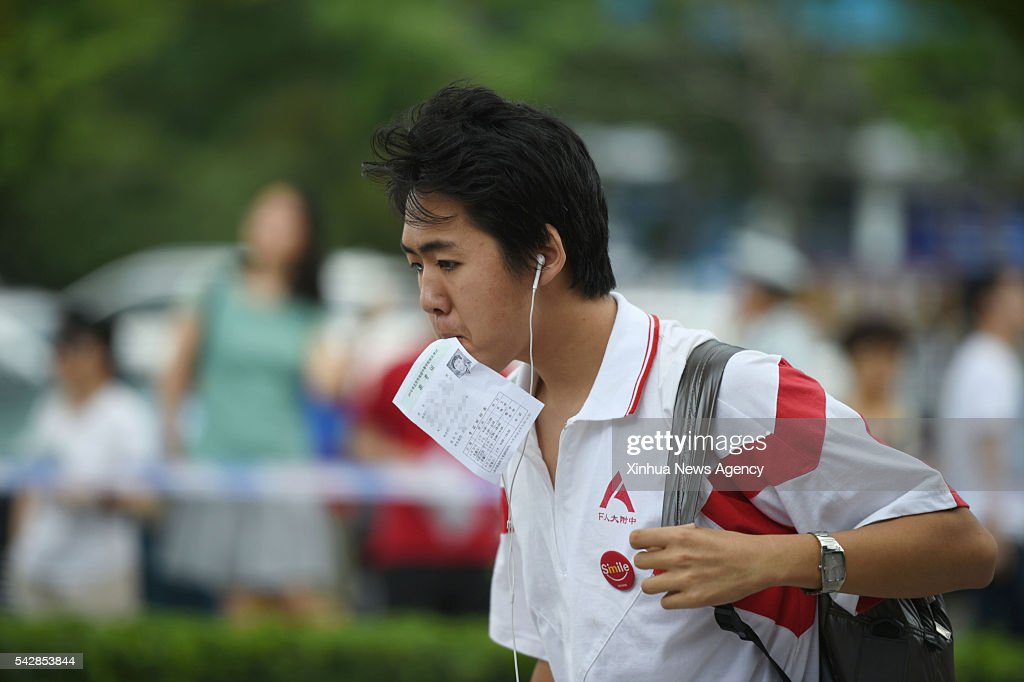 A student taking the 2016 senior high school entrance examination walks into the examination room at the High School Affiliated to Renmin University of China in Beijing, capital of China, June 24, 2016. About 70,000 middle school students participated in the three-day examination which lasts from June 24 to June 26 in Beijing.