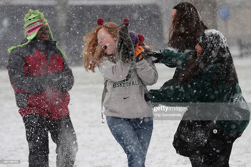 Student tourists from Chattanooga, Tennessee, have a snowball fight on National Mall January 21, 2014 in Washington, DC. A strong winter storm is bearing down on the East Coast between Virginia and Massachusetts and could dump four to eight inches of snow on the Washington area.