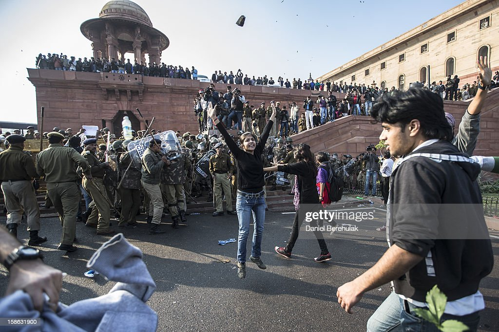 A student tries to calm down fellow protestors as rocks and other projectiles are thrown towards a cordon of Police during a protest against the Indian governments reaction to recent rape incidents in India in front of Rashtrapati Bhavan or the Presidential Palace on December 22, 2012 in New Delhi, India. Thousands of students gathered in front of the Presidential Palace in New Delhi to protest against current rape laws and the governments dealings of recent rape cases all over India.