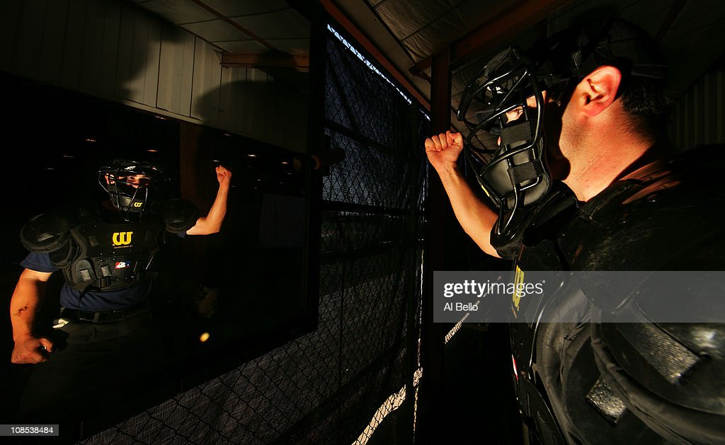 A student umpire works on his hand motion in the mirror before calling balls and strikes in a simulated game while under the watch of an instructor who is playing the role of a team manager at the indoor batting cages during the Jim Evans Academy of Professional Umpiring on January 27, 2011 at the Houston Astros Spring Training Complex in Kissimmee, Florida. Jim Evans was a Major League Umpire for 28 years that included umpiring four World Series. Many of his students have gone on to work on all levels of baseball including the Major Leagues.