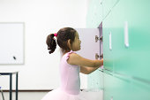 student using classroom locker