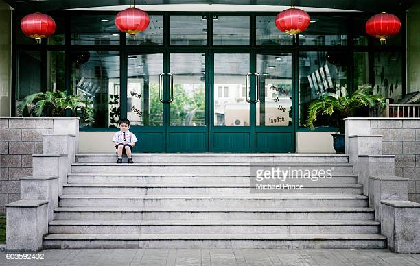 Student Waiting Outside School