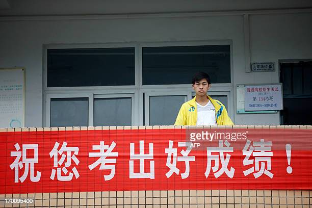 A student waits outside a classroom before sitting the 2013 university entrance exam at Xiyuan Middle School in Huaibei north China's Anhui province...