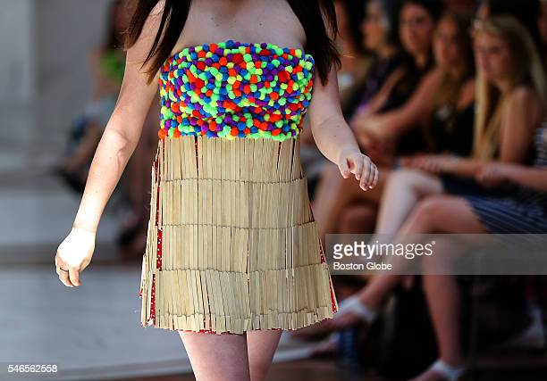 A student walks down the runway wearing a popsicle stick dress Burlington High School students showed off their fashion creations at the first ever...