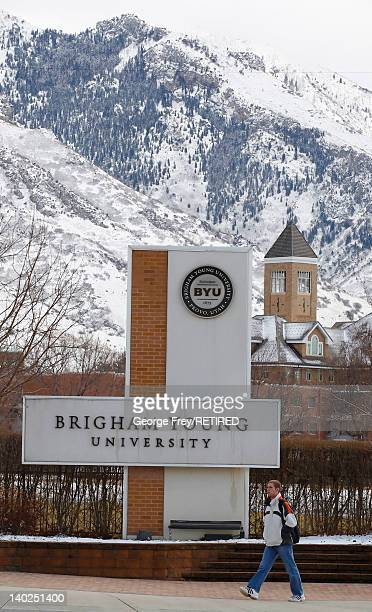 A student walks past the entrance of Brigham Young University on March 1 2012 in Provo Utah BYU is the alma mater of Republican US presidential...