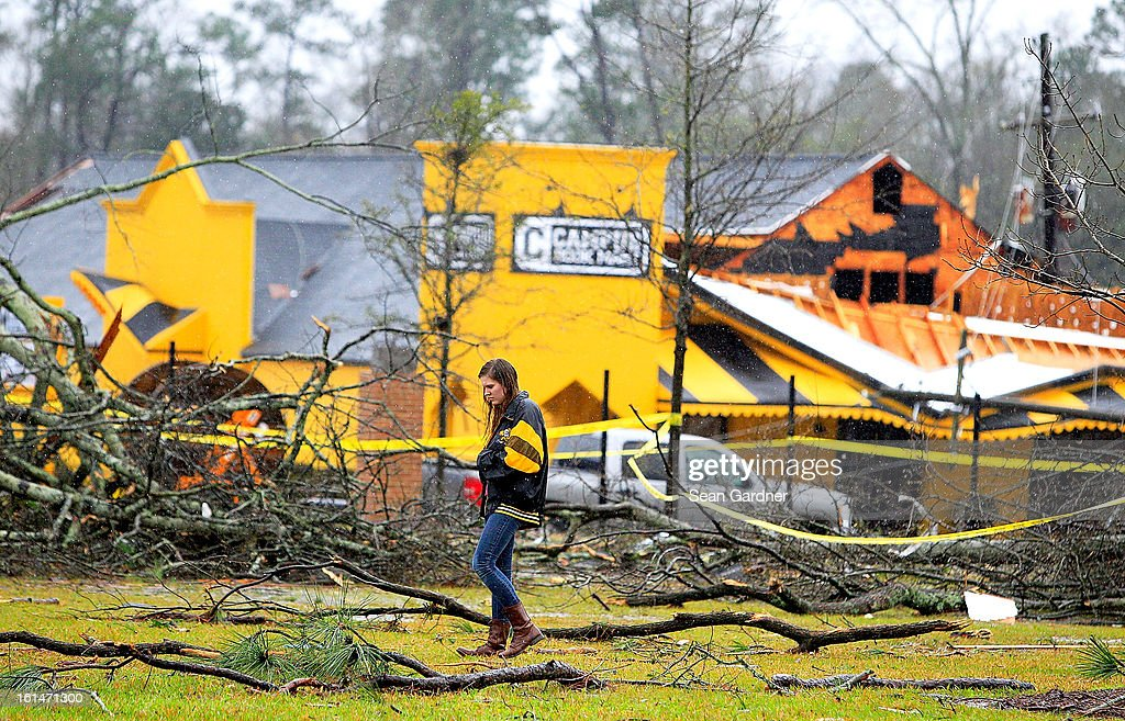 A student walks through debris on the campus of the University of Southern Mississippi after a tornado touched down yester evening on February 11, 2013 in Hattiesburg, Mississippi. Hundreds of homes were destroyed and over sixty people injured when the tornado ripped through the town.