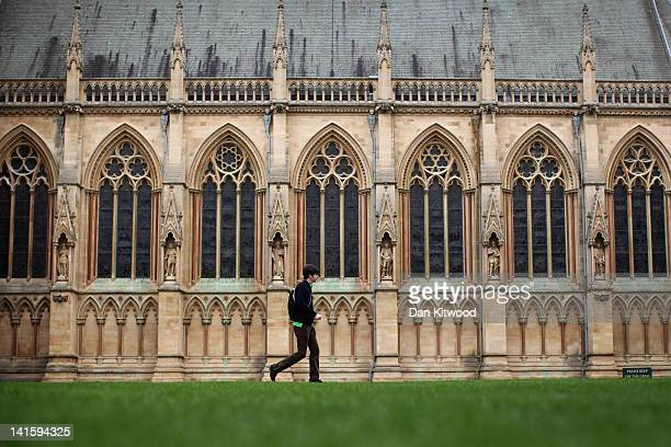 A student walks through St John's College on March 13 2012 in Cambridge England Cambridge has a student population in excess of 22000 spread over 31...