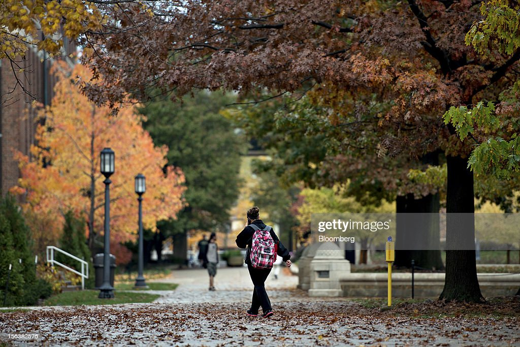 A student walks through the Purdue Mall on the campus of Purdue University in West Lafayette, Indiana, U.S., on Monday, Oct. 22, 2012. Administrative costs on college campuses are soaring, crowding out instruction at a time of skyrocketing tuition and $1 trillion in outstanding student loans. At Purdue and other U.S. college campuses, bureaucratic growth is pitting professors against administrators and sparking complaints that tight budgets could be spent more efficiently. Photographer: Daniel Acker/Bloomberg via Getty Images