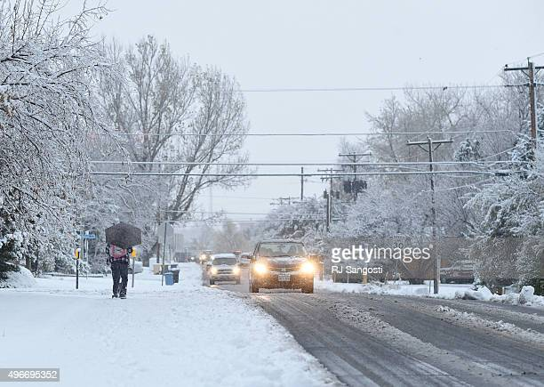 A student walks to school in Lakewood during a Veteran's Day snow storm the moved into the area overnight November 2015 Lakewood got almost 3 inches...