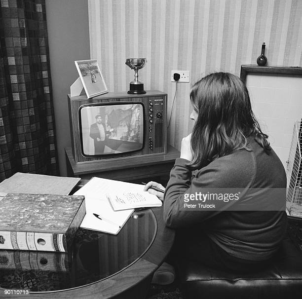 A student watching an Open University broadcast on TV 9th February 1971 A distance learning university the Open University works in association with...