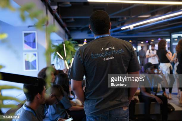 A student wears a thirt that reads 'The 1st Class' at the Facebook Inc Hack Station in Sao Paulo Brazil on Monday Dec 11 2017 The Facebook Inc Hack...