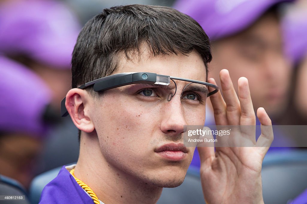 A student wears Google Glass at the 2014 New York University graduation ceremony at Yankee Stadium on May 21, 2014 in the Bronx borough of New York City. Janet Yellen, Chair of the Board of Governors of the Federal Reserve System, received an honorary doctorate and was the 2014 commencement speaker.