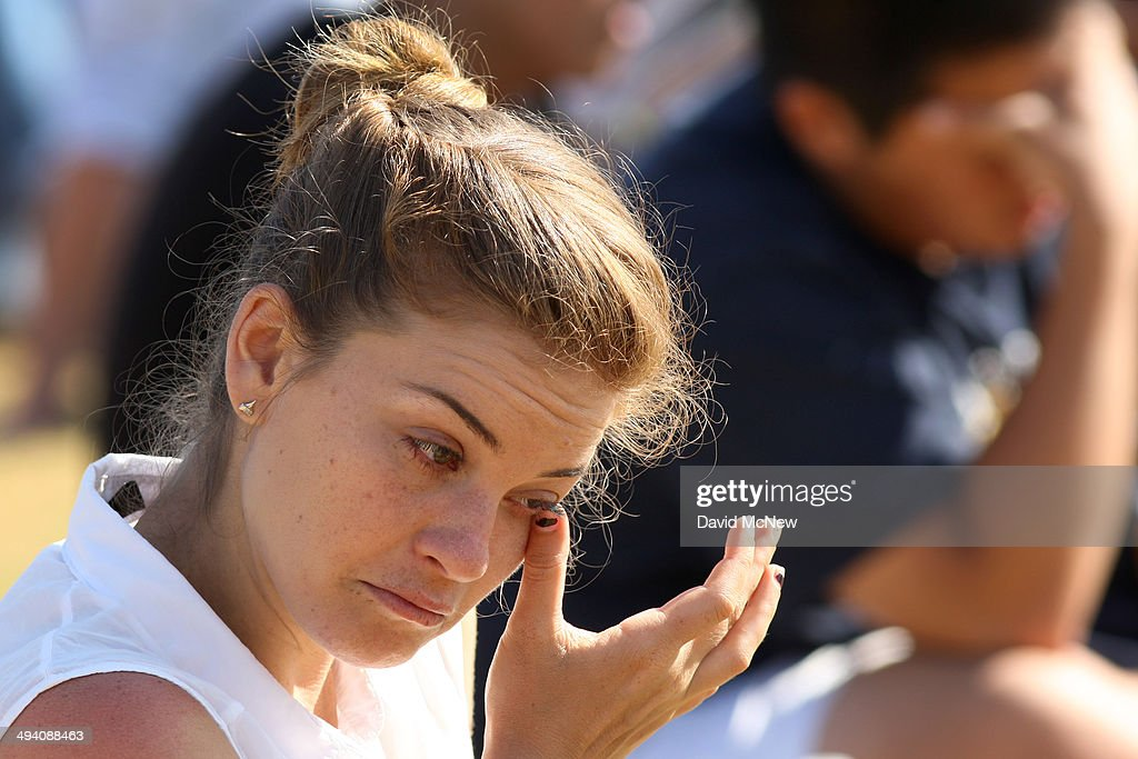 A student wipes away a tear at a public memorial service on the Day of Mourning and Reflection for the victims of a killing spree at University of California, Santa Barbara on May 27, 2014 in Isla Vista, California. Elliot Rodger killed six college students at the start of Memorial Day weekend and wounded seven other people, stabbing three then shooting and running people down in his BMW near UCSB before shooting himself in the head as he drove. Police officers found three legally-purchased guns registered to him inside the vehicle. Prior to the murders, Rodger posted YouTube videos declaring his intention to annihilate the girls who rejected him sexually and others in retaliation for his remaining a virgin at age 22.