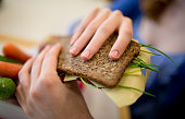 Student with a healthy breakfast lunchbox filled with wholewheat bread fruit and vegetables on September 19 in Goettingen Germany The...