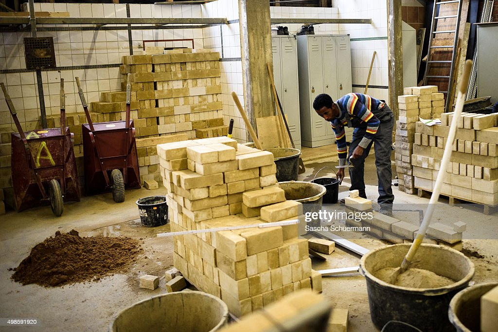 A Student with an immigrant background working as a bricklayer at the Vocational training center of the Chamber of Crafts (Bildungszentrum Butzweilerhof der Handwerkskammer) on November 24, 2015 in Cologne, Germany. German industry has complained in recent years of being unable to fill tens of thousands of trainee positions and some see the influx of nearly a million migrants this year as a possible opportunity to narrow the gap.