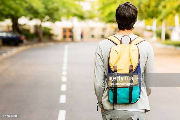 Student With Backpack Walking On Street