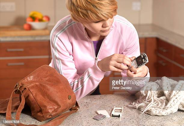 Student with broken mobile phone
