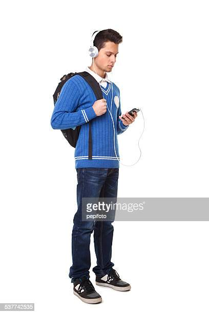 student with cell phone and headphones
