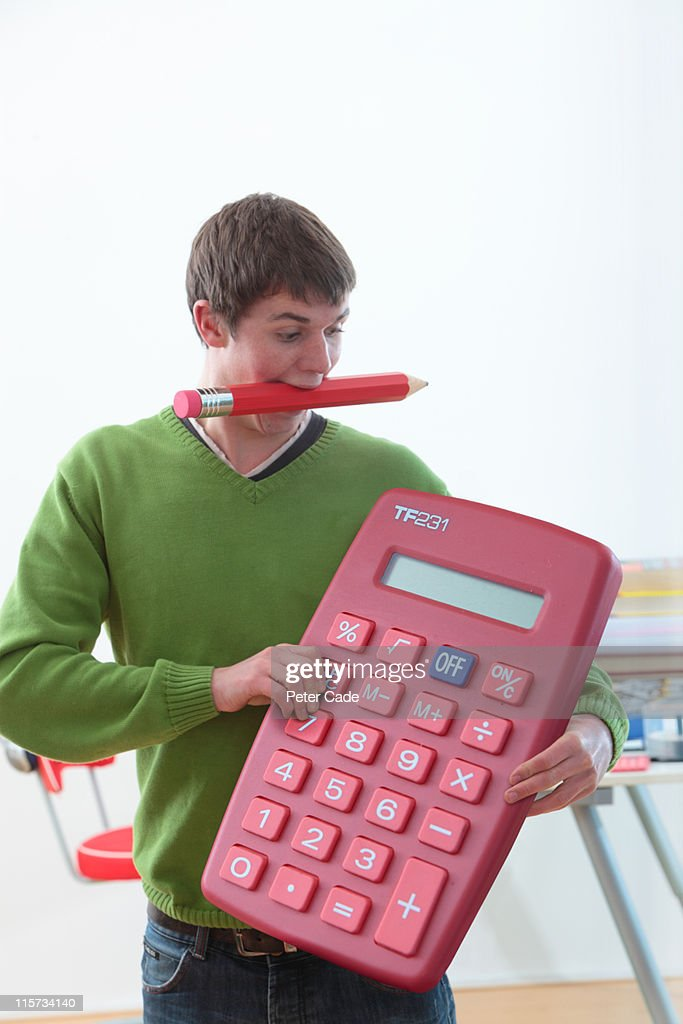 student with giant pen and calculator : Stock Photo