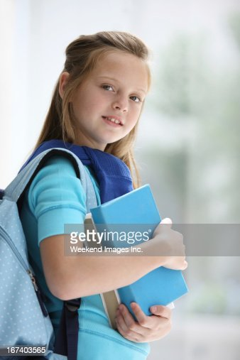 Student with textbooks : Stock Photo