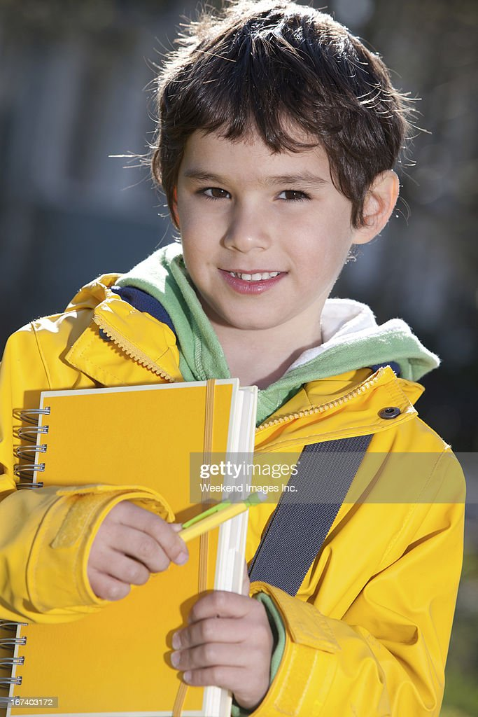 Student with yellow book : Stockfoto