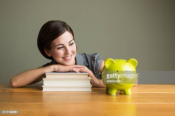 Student woman with piggy bank
