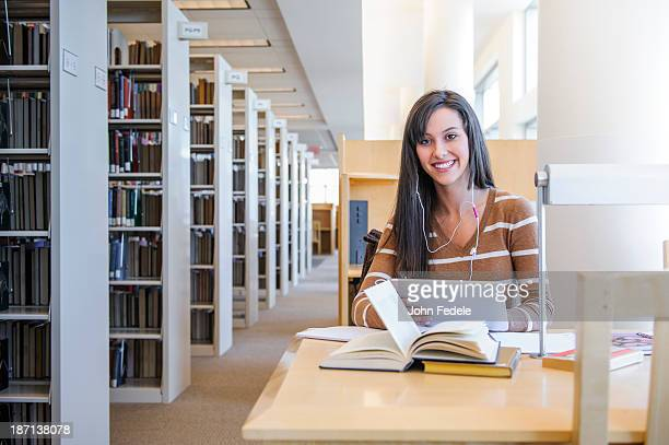 Student working at desk in library