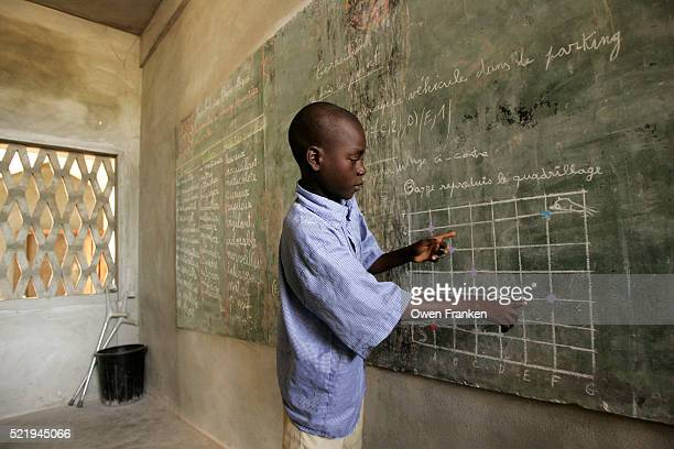 Student Working at the Blackboard