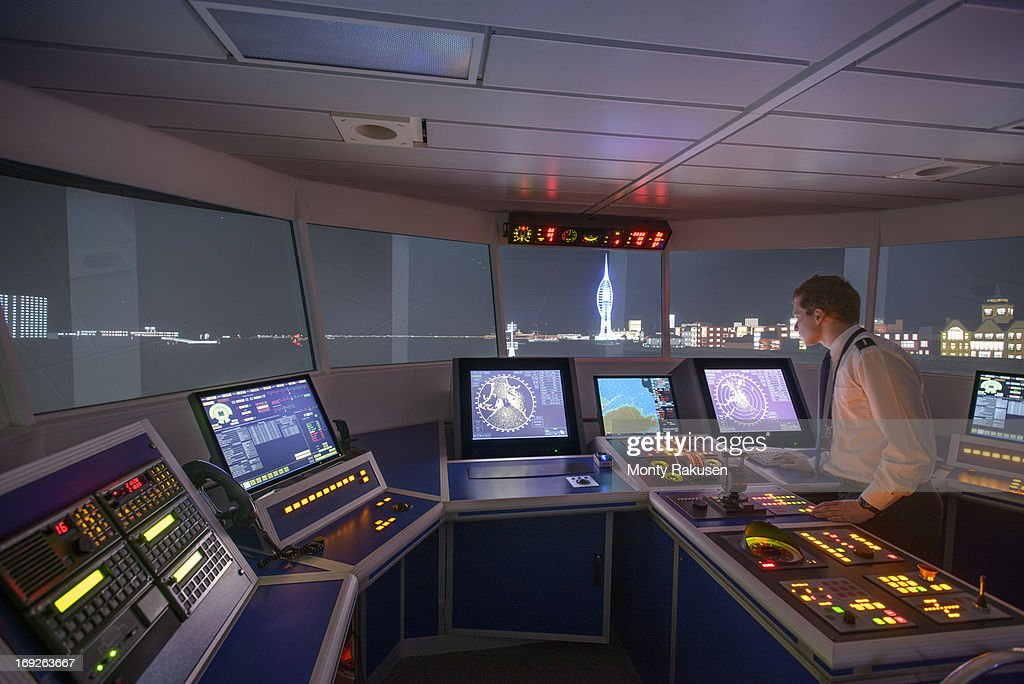 Student working in ship's bridge simulation room during night scene