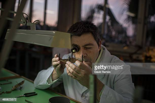 A student works on the mechanism of a table clock as he attends a class at the secondary school Mare de Deu de la Merce on March 10 2015 in Barcelona...