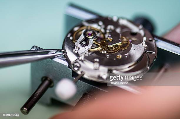 A student works on the mechanism of a wristwatch as he attends a class at the secondary school Mare de Deu de la Merce on March 10 2015 in Barcelona...