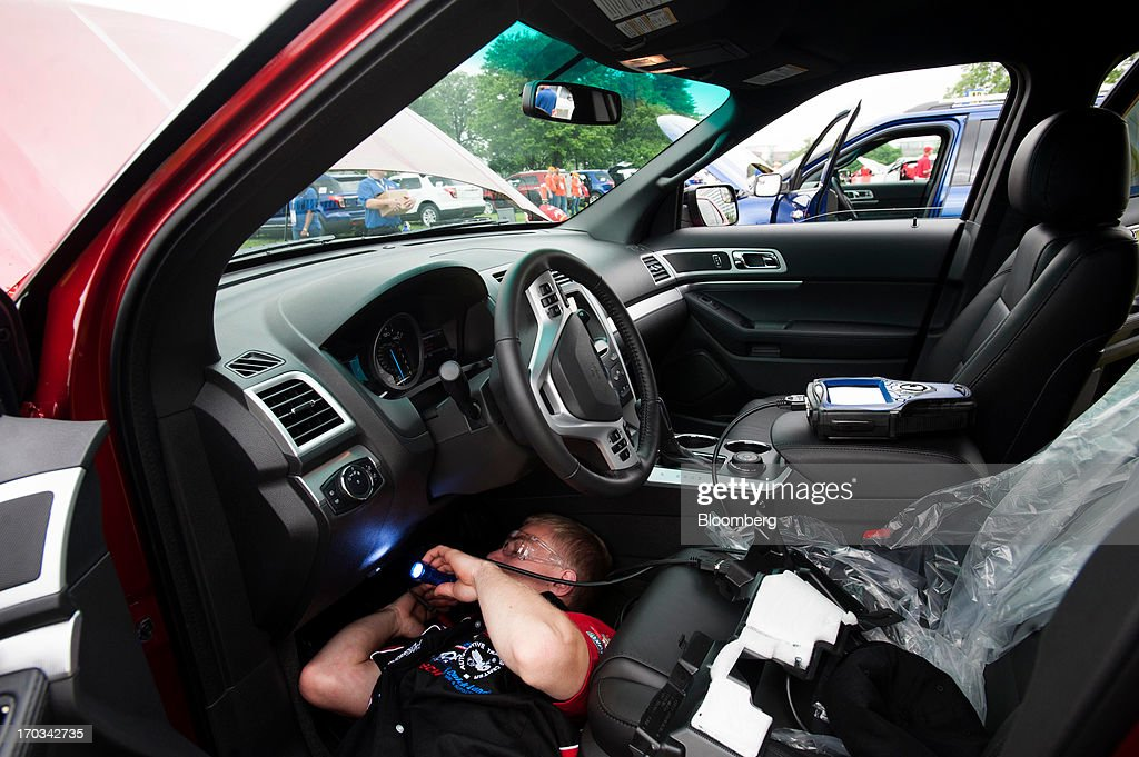 A student works under the dash of a Ford Motor Co. Explorer at the National Finals of the Annual Ford/AAA Student Auto Skills Competition at the Ford World Headquarters in Dearborn, Michigan, U.S., on Tuesday, June 11, 2013. Job openings in the U.S. fell in April, showing companies were waiting to assess the effects of higher taxes and reduced government spending before committing to bigger staff increases. Photographer: Ty Wright/Bloomberg via Getty Images