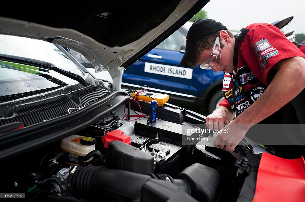 A student works under the hood of a Ford Motor Co. Explorer at the National Finals of the Annual Ford/AAA Student Auto Skills Competition at the Ford World Headquarters in in Dearborn, Michigan, U.S., on Tuesday, June 11, 2013. Job openings in the U.S. fell in April, showing companies were waiting to assess the effects of higher taxes and reduced government spending before committing to bigger staff increases. Photographer: Ty Wright/Bloomberg via Getty Images