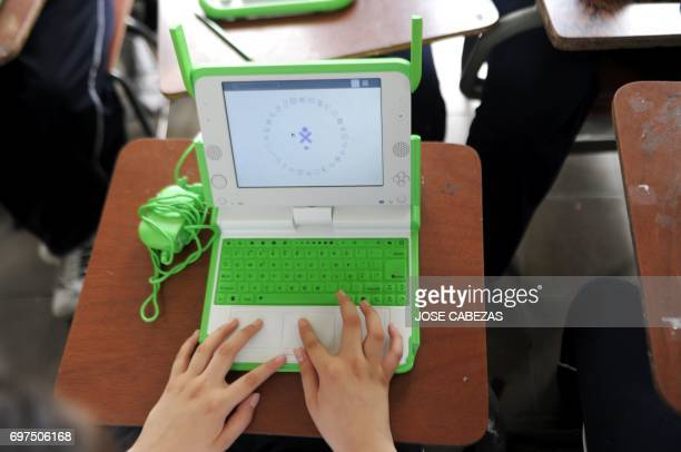 A student works with his OLPC XO laptop at the Nuestra Senora del Rosario Catholic School in San Marcos 5 km south from San Salvador El Salvador on...
