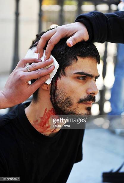 A student wounded during the police clashes is rescued by other students at Scuola Superiore Sant'Anna on April 23 2013 in Pisa Italy Clashes between...