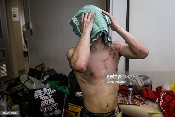 A student wrestler recovers after his fight during the Student ProWrestling Summit on February 26 2015 in Tokyo Japan Members of college prowrestling...