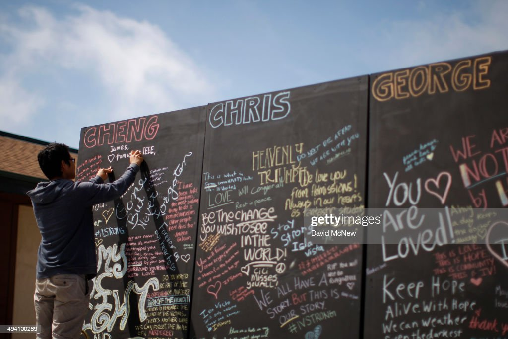 A student writes chalk messages on a memorial wall for slain students on the Day of Mourning and Reflection for the victims of a killing spree at University of California, Santa Barbara on May 27, 2014 in Isla Vista, California. Elliot Rodger killed six college students at the start of Memorial Day weekend and wounded seven other people, stabbing three then shooting and running people down in his BMW near UCSB before shooting himself in the head as he drove. Police officers found three legally-purchased guns registered to him inside the vehicle. Prior to the murders, Rodger posted YouTube videos declaring his intention to annihilate the girls who rejected him sexually and others in retaliation for his remaining a virgin at age 22.